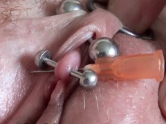 Real Clitoris piercing and through with a needle